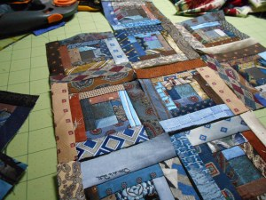 Log cabin block foundations done with blue and brown ties.